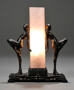 Frankart Table Lamp Glass and painted metal Square pink glass shade flanked by two nude female figures with knee bent on stepped platform base in black finished metal, marked Frankart with c in a circle Pat. Lampe Art Deco, Art Deco Decor, Art Deco Design, Decoration, Design Design, House Design, Art Nouveau, Interiores Art Deco, Design Industrial