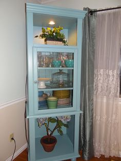 Repainted an old cabinet from black to pale blue. It used to be stuck in a corner of the basement. Now it houses china and crystal! #repainting
