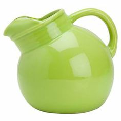 """Add a colorful touch to your table with this ceramic pitcher, showcasing a lime finish for bright style.   Product: Pitcher    Construction Material: Ceramic    Color: Lime    Features:  Classic shape Decorative piece when not in use   Dimensions: 8"""" Diameter  Note: For cold beverages only  Cleaning and Care: Hand wash"""