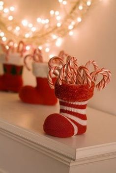Baby Christmas socks w/empty toilet paper rolls to hold upright fill with candy canes = Voila