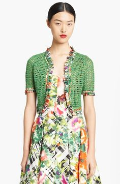 The addition of this Oscar de la Renta Hand Crochet Bolero over the taffeta dress is super retro.