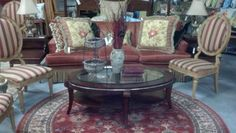 Put together a whole new look with rugs, sofa, tables, and chairs