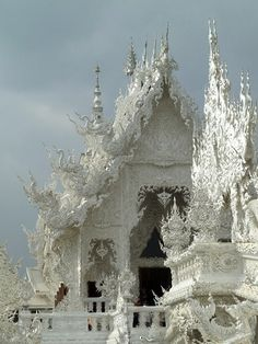 Yesterday I came across the strangest temple I have ever seen in my entire life. It's the Wat Rong Khun buddhist temple in Chiang Rai, Thailand. The sanctuary was conceived by acclaimed Thai arti Nature Architecture, Beautiful Architecture, Beautiful Buildings, Gothic Architecture, Ancient Architecture, Buddhist Architecture, Places Around The World, Oh The Places You'll Go, Places To Travel