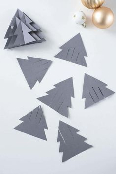 DIY: Kunstvolle Papiertannen in - HANDMADE Kultur The ornate firs made of paper are very easy to copy. You cut out the template and put the individual elements together. Without long wrinkles