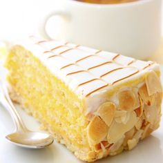This almond cake recipe is made with a cake, drizzled with almond syrup that soaks in then coated with a vanilla glaze. The roasted almond slivers add a nutty flavor. This is a good cake to serve for afternoon coffee break.