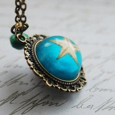 Real Starfish Necklace Turquoise Green by NaturalPrettyThings    Love the ocean look, the starfish makes it <3