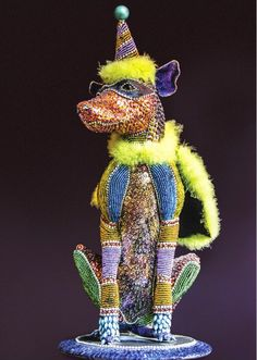 Nancy Josephson is bead artist who makes wonderful, really uniqe beaded art. Such as decorative items for the interior, beaded animals, birds, candlestick, mirrors and even urns!