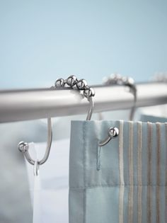 Shower Curtain Rod Hooks for both liner and cloth curtains (Creative Specialties by Moen Shower Ring at Walmart Online)