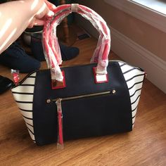 Awesome Satchel Handbag This bag is soooo crazy cute! Love it! Red, blue, white and gold! Dimensions - 10.75 inches high and 12 inches wide! Call It Spring Bags Satchels