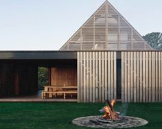 fearon hay architects' timber-clad forest house reconnects to its rural roots in auckland