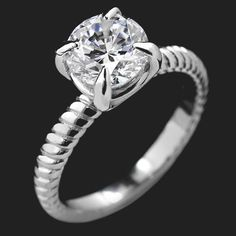The Charming Solitaire Engagement Ring is inspired by David Yurman's twisted cable band design featuring your choice of 2.0ct Round Cut center stone in a basket prong head with claw prongs atop a twisted band.Starting price is for setting only.|This ring can be ordered in two tone or single tone in your favorite eco-friendly metal type.This ring does not have a matching wedding band