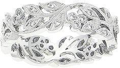 18k White Gold Pave Diamond Floral Band  : Round brilliant diamonds are pave-set in this beautiful 18 karat white gold floral band with milgrain edges.
