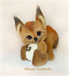 Squirrel Yuki 14 cm with ears made of three kinds of German fur, filled with metal granulate and hollofaybrom, glass eyes. Mounting on the cotter pin, cotter pin head on double toned art oil.  Used in avstralisyky merino, silk ribbon, copper pendant. Yuki - Japanese language translates as Autumn