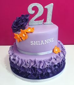 21st Purple ruffled birthday cake with a touch of orange.