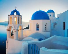 Santorini, Greece is a wonderful place to visit. Visit the many churches and see how they plant their grapes. Enjoy!