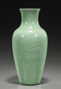 Chinese Celadon Glazed Porcelain Vase Early 18th Century-style, Chinese celadon glazed porcelain vase; ovoid form with moulded designs of writhing dragons above waves chasing flaming pearls