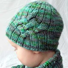 f02678fe984 Free pattern for a knitted baby hat with cables up the side. Includes both a