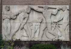 Bas-relief sculptures from Chicago Stadium, appended onto St. Ignatius' gymnasium. The Stadium was designed by the firm of Hall, Lawrence, a...
