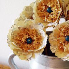 Paper Flowers    http://www.etsy.com/listing/78427943/handmade-flower-vintage-paper-bloom