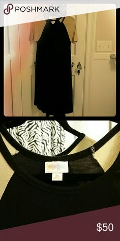 LuLaRoe XS Carly Black hi-low dress with tan sleeves. Worn a couple times only. 95% rayon/5% spandex. LuLaRoe Dresses High Low