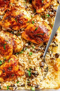 Easy Oven Baked Chicken And Rice With Garlic Butter Mushrooms mixed through is winner of a chicken dinner! Chicken thighs bake on top of buttery, garlicky, soft and tender rice with crispy edges. ALL the chicken flavours … Easy Oven Baked Chicken, Easy Chicken And Rice, Baked Chicken Recipes, Chicken Thighs In Oven, Chicken Tights Recipes, Oven Chicken And Rice, Oven Baked Rice, Garlic Chicken, Chicken Thigh Recipes Oven