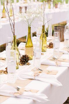 diy wine bottle center piece idea #weddingreception #tabledecor #weddingchicks http://www.weddingchicks.com/2014/02/20/casual-elegance-wedding-for-under-7k/