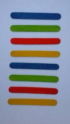 Gekleurde stokjes naleggen