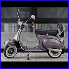 Very nice Vespa scooter in muted purple.