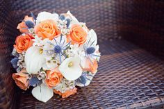 calla lilies, roses, thistle and hydrangeas in navy, coral and white wedding color theme