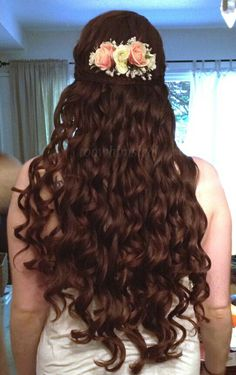 My wedding hair, after my trial this weekend! A half updo, with soft curls, some little braids, and a flower comb from Etsy. I'm so excited :D
