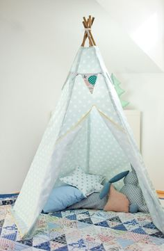 Fun ideas on this blog for cozy tents. These could make a great reading corner in a classroom!