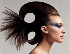 Fish inspired hair with cool editorial makeup