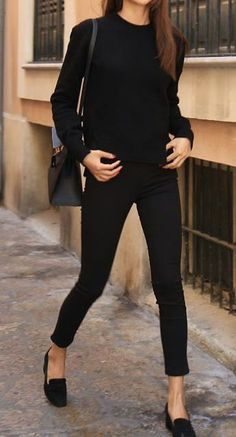 loose black sweater, bun, loafers & cuffed black jeans for work