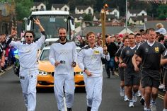 Muse con la llama olímpica