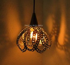 Soda can tab lamp shade.
