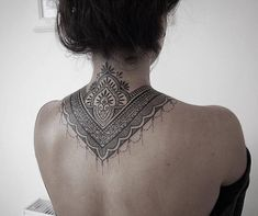 Ornamental style tattoo covering back of the neck and upper back.Done by Alex Bawn #upperbacktattoos