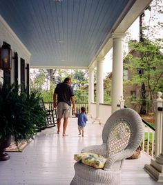 Blue ceiling...grey floor...columns...shutters...rocking chairs ferns and wicker make the porch...All it needs is a porch swing and a trellis with old fashioned light pink saucer size roses climbing up it.