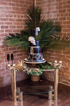 This glam gold and black tropical wedding is filled with exotic elegance. It's an indoor tropical paradise of palm trees, exotic flowers and striking gold details with pops of teal and fuchsia. Palm Wedding, 1920s Wedding, Wedding Cake Rustic, Amazing Wedding Cakes, Elegant Wedding Cakes, Tall Gold Vases, Bridal Party Tables, Exotic Flowers, Wedding Bouquets