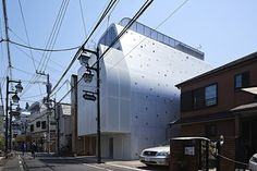 tiny apertures illuminate tokyo apartment building by A.L.X. / junichi sampei
