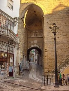 Arco de Almedina or also called Almedina Arch is a a 12th century gateway in the city of Coimbra; Portugal. Its lined with the city's best souvenir shops.