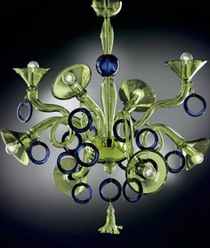 A fun and original green and blue Murano glass chandelier. This one is great! As it's made to order, you get to design it yourself by choosing the colours you'd like! Go 70s style with orange and green, or nautical with white and blue...It's up to you! www.italian-lighting-centre.co.uk/murano-glass/demajo-laguna-planet-custom-chandelier-p-1522.html#.VPgs-i42VL9