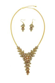 Our rhinestone-studded articulated floral necklace coalesces around a blooming centerpiece before suggestively trickling down to reveal a trail of petals. Available in thickly plated gold or silver. Matching drop earrings complete the set.   Spring Bling Set by Made It!. Accessories - Jewelry - Necklaces Accessories - Jewelry - Earrings New Jersey