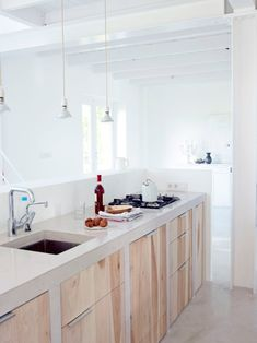 light, natural wood kitchen cabinet doors found at - Interior Inspiration From The Netherlands Home Kitchens, Concrete Kitchen, Kitchen Decor, Modern Kitchen, Kitchen Countertops, New Kitchen, Kitchen Interior, Interior Design Kitchen, Kitchen Style