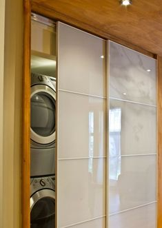 Love the sliding doors! Washer and dryer in closet