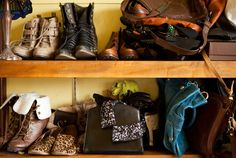 """""""My messy display of bags and shoes and gloves includes some of my favorites: my blue leather GGL bag, my vintage Salvatore Ferragamo box clutch, and my Jeffrey Campbell boots. I bought the Salvatore Ferragamo clutch for $12 at a vintage store,"""" said fashion blogger Kristen Lam."""