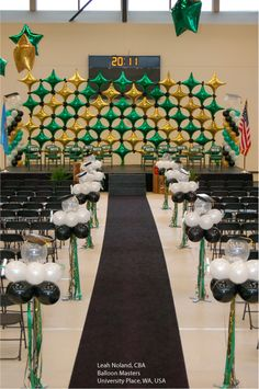 Starpoint Decor Shapes in the school colors make a great backdrop for graduation ceremonies. Design by Leah Noland, CBA, of Balloon Masters in University Place, WA, USA.
