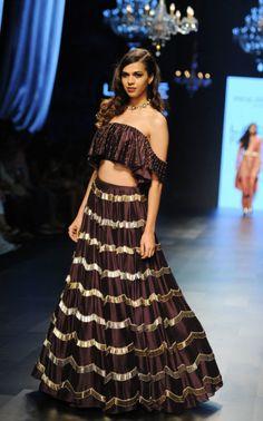 If you want something sexier, get a tinier version like this off-shoulder choli. Dandiya Dress, Bridal Nightwear, Ghaghra Choli, Bridal Lehenga Choli, Saree, Black Indians, Lakme Fashion Week, Indian Couture, Bridal Outfits