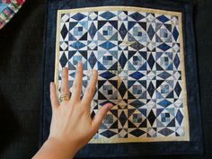 Tiny blue and white quilt - couldn't decide to pin it on blue and white or miniatures!  Love this!