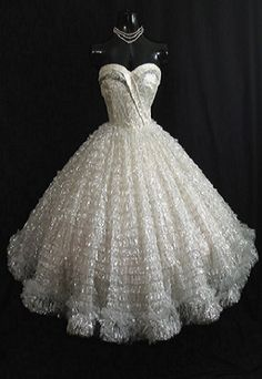 Drop dead gorgeous strapless 1950's party dress in breathtaking white lace, with silver metallic tulle. No maker label.