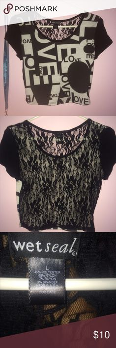 "crop top crop top with black writing ""love"", lace detailing all over the back, never worn Wet Seal Tops Crop Tops"